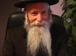 עוד תואר. הרב יצחק דוד גרוסמן (צילום: ישראל ברדוגו)