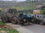 פינוי רכב המחבל מזירת הפיגוע בכפר נעמה