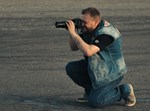 עיתונאי/צלם. אילוסטרציה