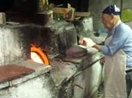 """ר' אליהו ז""""ל בעבודתו מול התנור"""