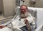 הרב משה שיינרמן מתחנן ממיטת חוליו
