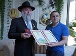 """הרב מרקוביץ' ויו""""ר הוועדה הפרלמנטרית וחבר הפרלמנט אלכסנדר קוניצקי"""