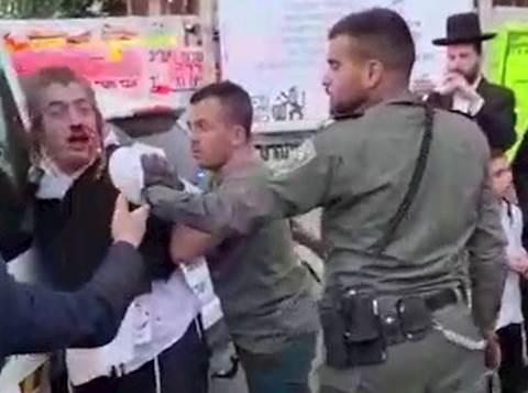 יענקי מותקף בידי השוטרים