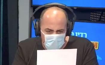 העיתונאי אלי לוי